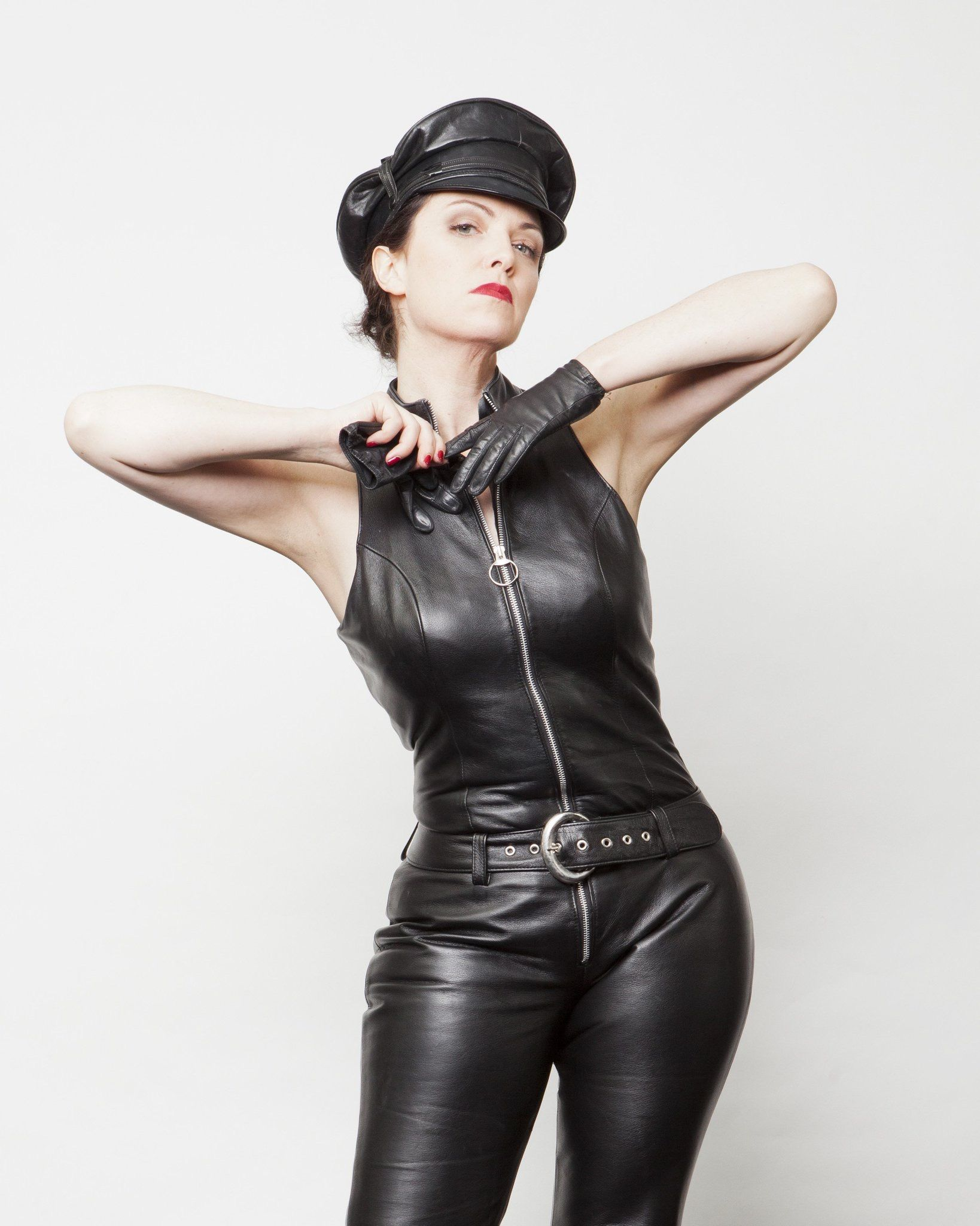 8cab633f6b Dominant Lady in a sleeveless Uniform Style black Leather Jumpsuit ...