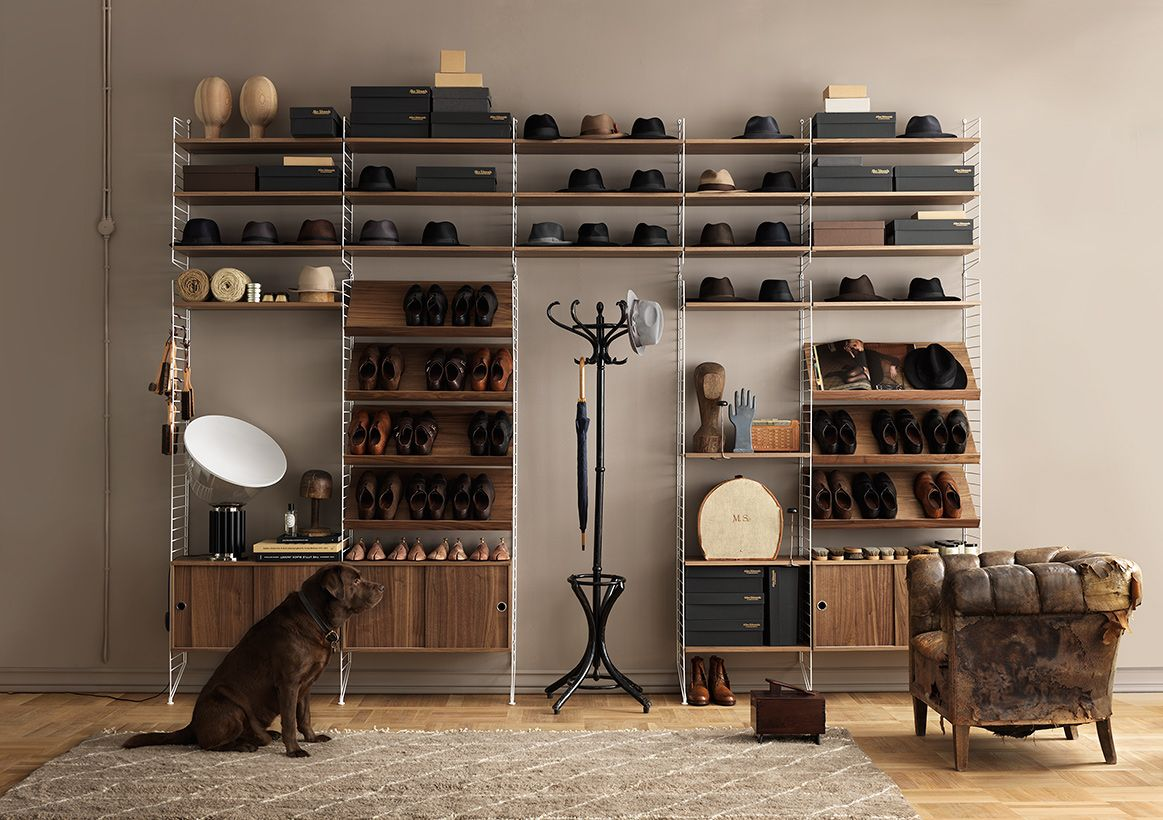 String shelving in walnut and white with Enzo - the dog!