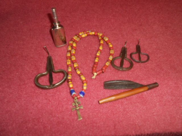 HERE IS SOME OF OUR COLLECTIBLES ,A OIL CAN FROM 1897 , THREE JEW HARPS FROM CIVIL WAR , BEADS FROM 18 CENTURY ,STRAIGHT RAZOR FROM THE REVOLUTIONARY WAR, AND A JESUIT CROSS OF LORAINE FROM 17 CENTURY PHOTO BY Paula Ptak........