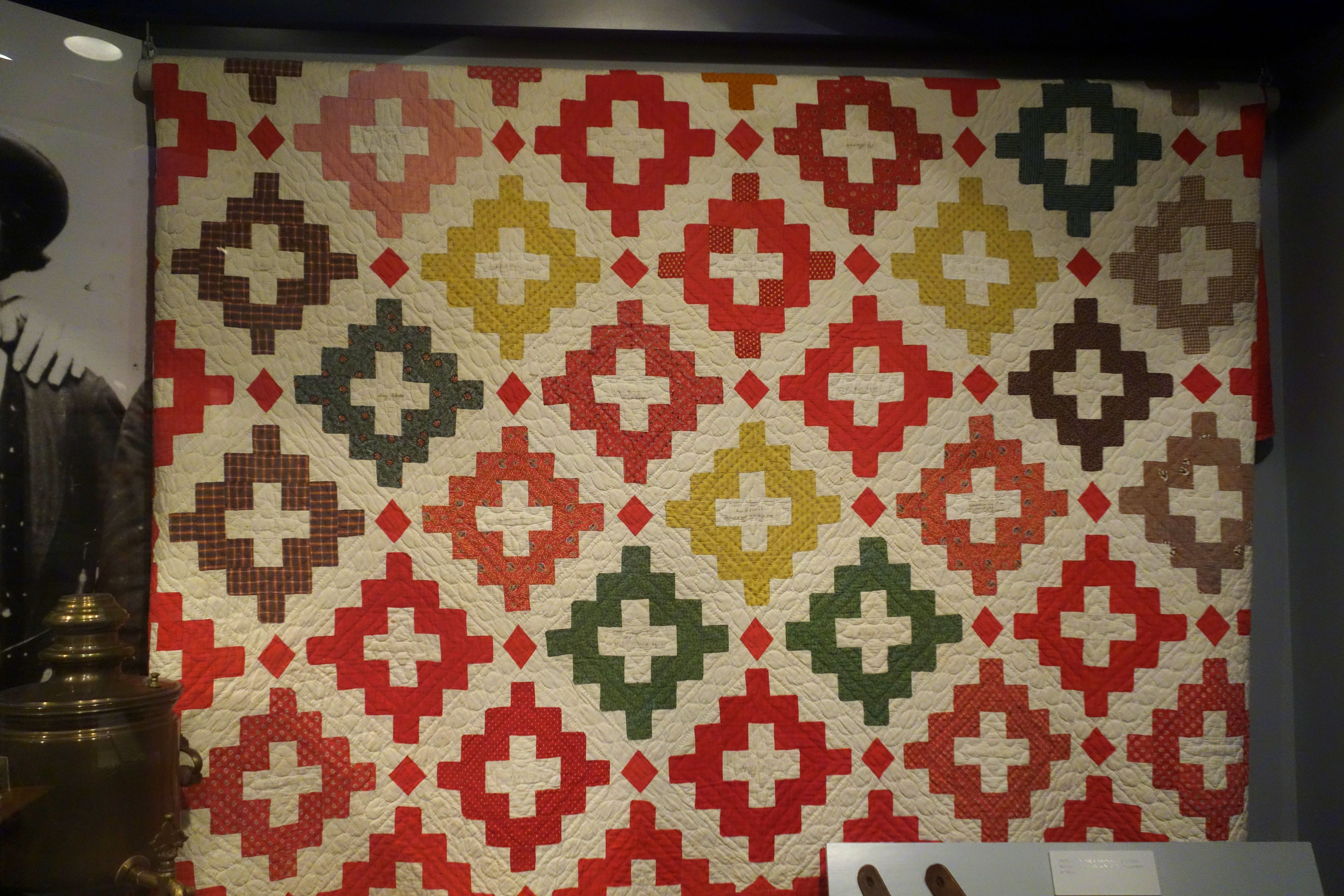1849 antique quilt - block is called courthouse steps here, but is more commonly known as the chimney sweep or Christian cross block.
