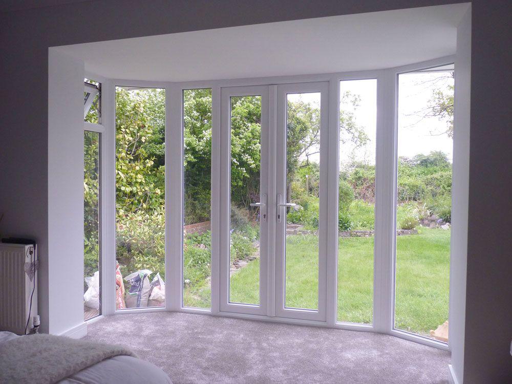 Wooden shutters on a UPVC bedroom bay window in Emsworth ...