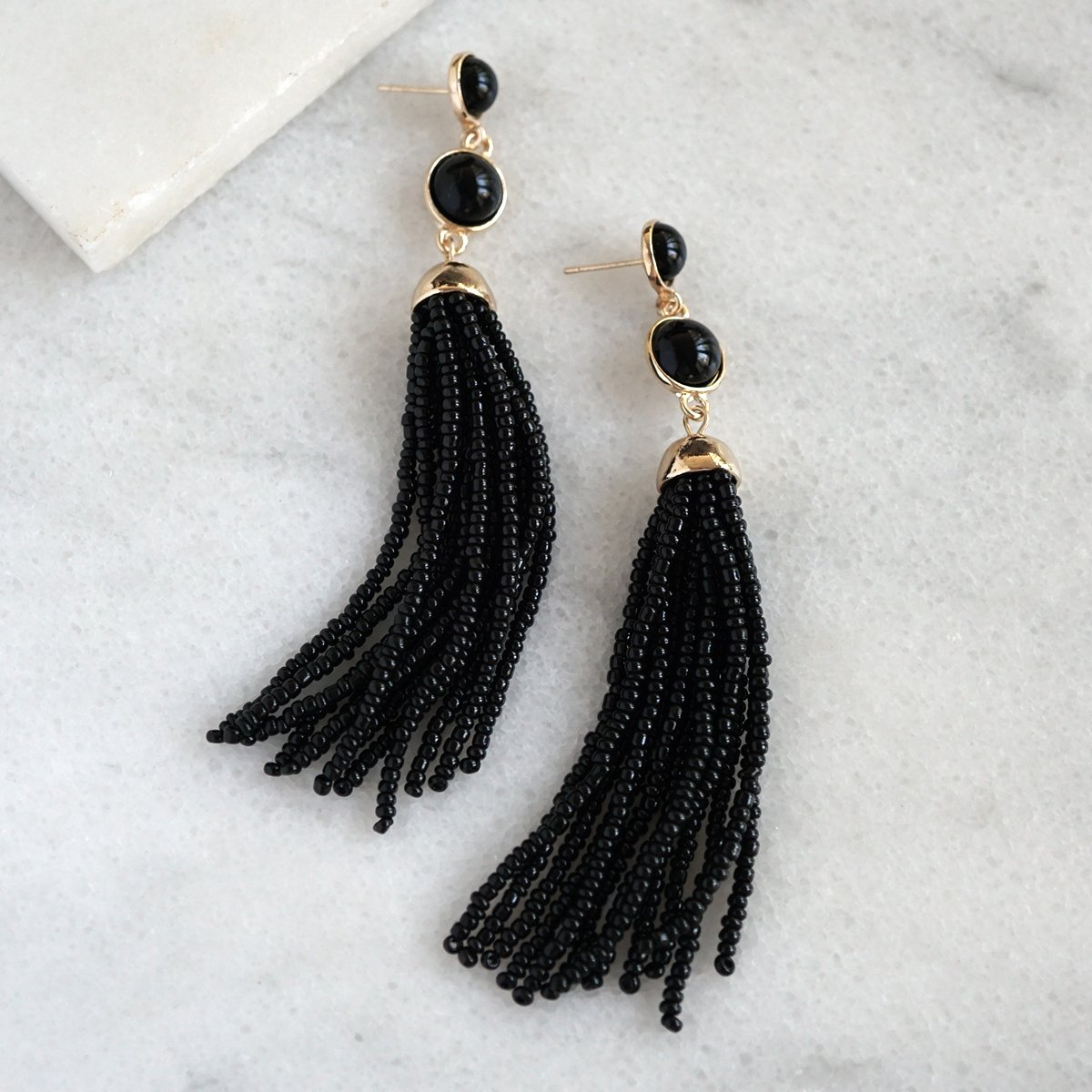Beaded tassel earrings in black Beaded tassel earrings