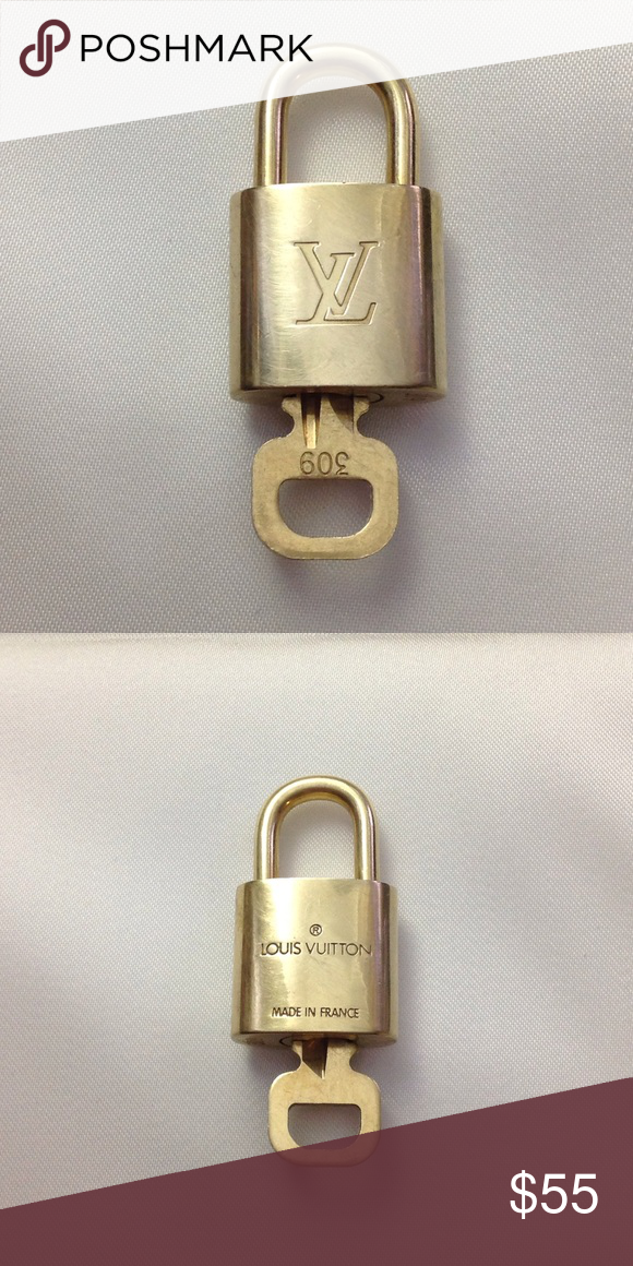 Authentic Loui Vuitton Lock and Key 320 Vuitton, Louis