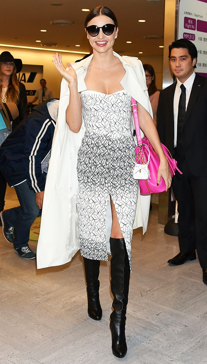 Miranda Kerr in embellished white midi dress and white trench with pink bag