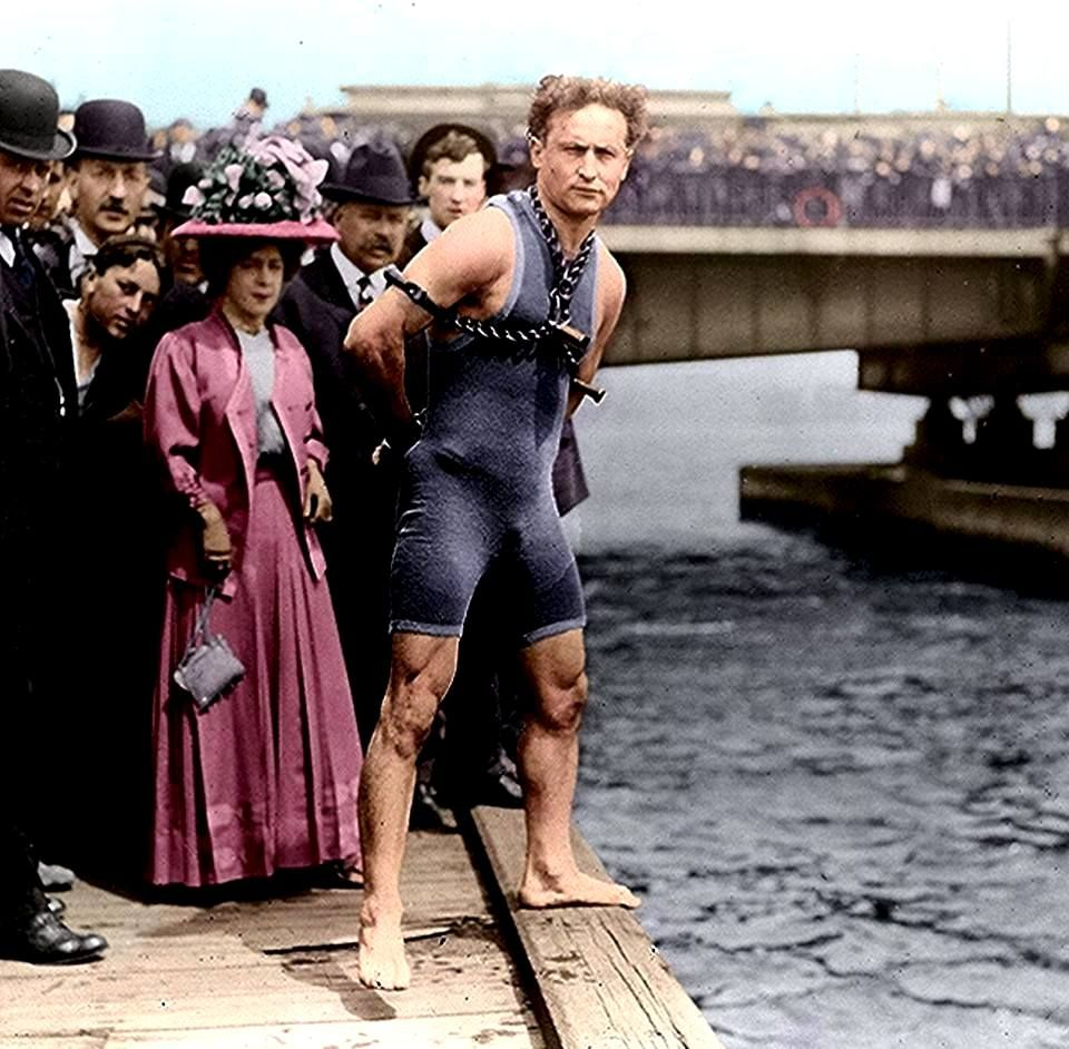 I found this colorized photo of Houdini in cuffs and shackles....