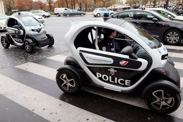 Policemen Drive Renault Twizy Electric Cars In The Street On The