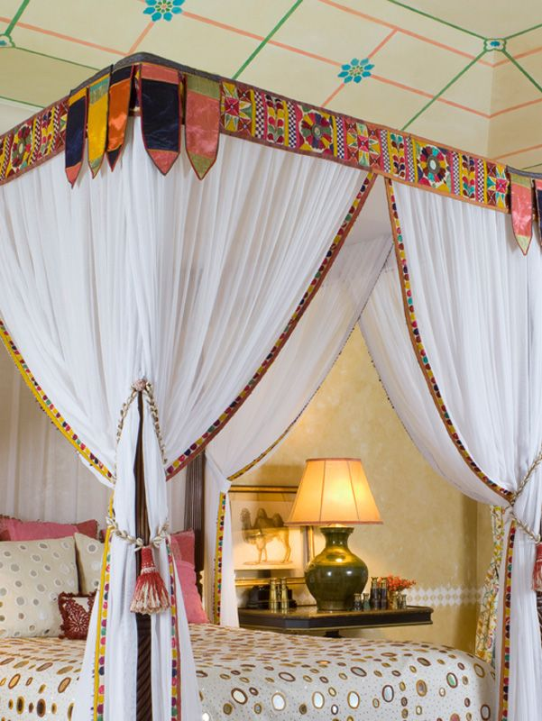 Frank de Biasi Interior - detail of draped bed and painted ceiling.