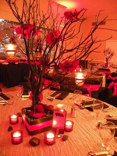 Black manzanita trees red orchids and hanging tealights