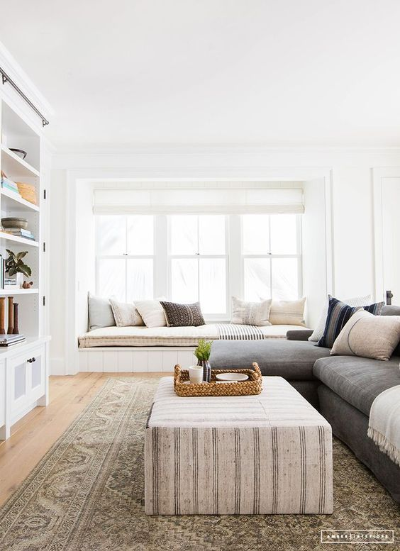 Restful neutral living room decor with a built in window seat and ...