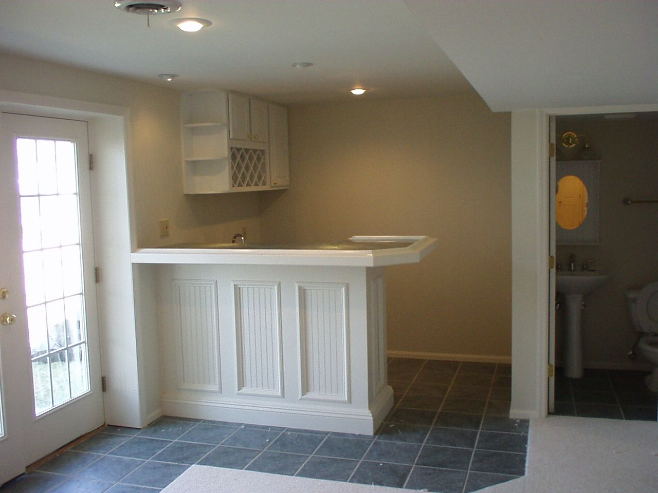 Small finished basement ideas finishing companies by for Finished basement designs
