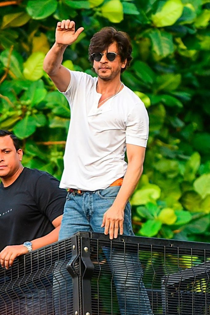 Shah Rukh Khan attends the wave hands with fans outside