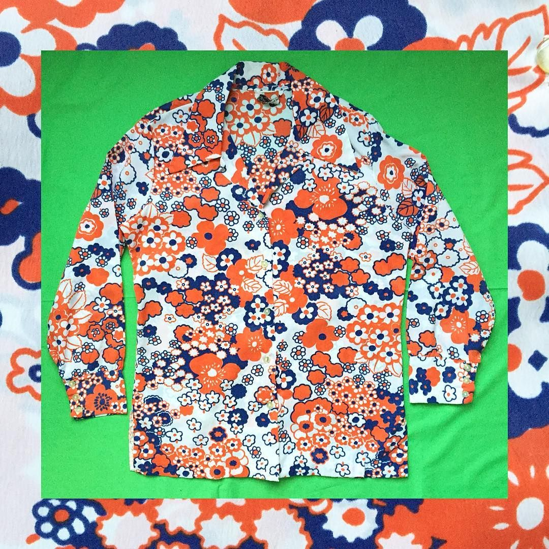 These people know how to merchandize - https://www.instagram.com/theunicorngraveyard/  - Sold!!  Vintage blue and red floral button up blouse. Size large, bust 42, length 25 inches