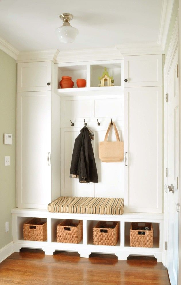Chic Entryway trend New York Traditional Entry Inspiration with beige molding beige trim built-in bench built-in seat coat hooks coat rack cubbies entry