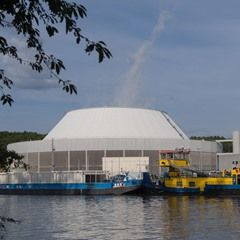 A barge loaded with radioactive waste docks at the Neckarwestheim Nuclear Power Station