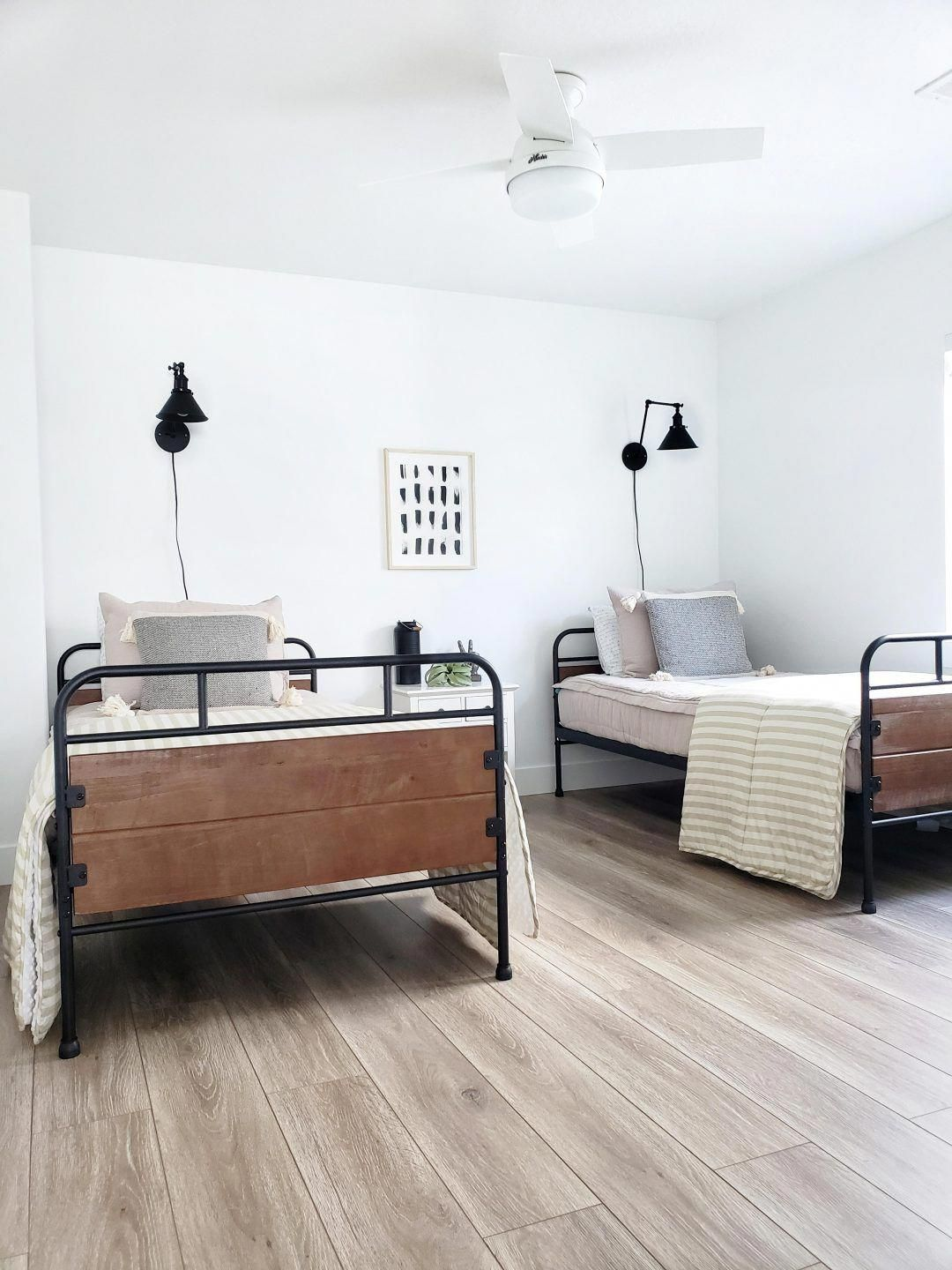 @whitelanedecor #whitelanedecor Beddy's Bed, twin trundle beds, black swing arm wall sconce, neutral bedroom, basement bedroom, black metal twin beds, side by side black metal twin beds, zipper bedding, Beddy's Oh So Boho. Basement Ideas. #whitebedroom #beddysbedding @whitelanedecor #whitelanedecor Beddy's Bed, twin trundle beds, black swing arm wall sconce, neutral bedroom, basement bedroom, black metal twin beds, side by side black metal twin beds, zipper bedding, Beddy's Oh So Boho. Basement #beddysbedding