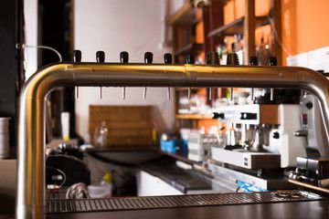 Image of modern beer bar with metal beer taps