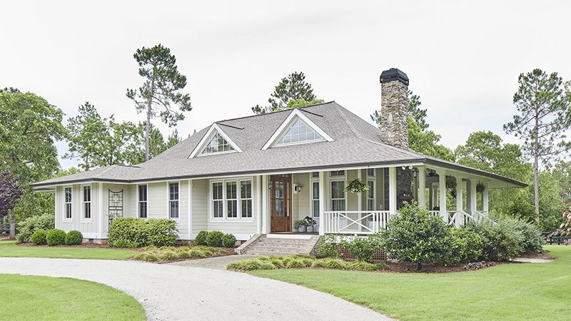 New Tideland Haven Welcomes You With Its Grand Wraparound Porch Once Inside Soaring Nine Fo In 2020 Coastal House Plans Southern Living House Plans Porch House Plans