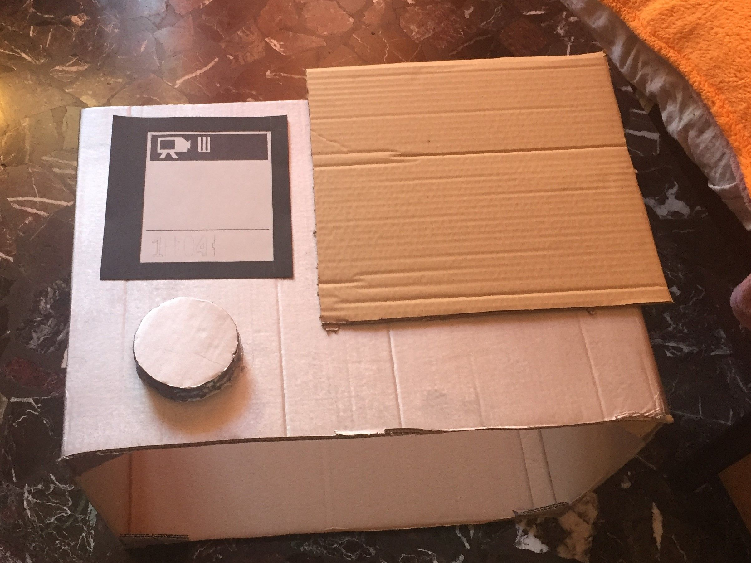 Step 3) Draw the classic display of the action camera on some different colors light cardboards.