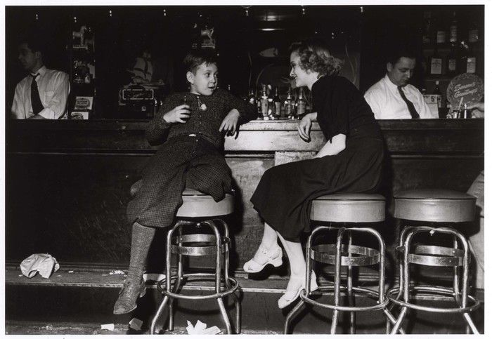 [Young boy and woman sitting on barstools in a nightclub, Calumet, Illinois]