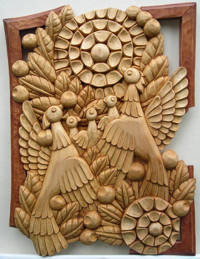 Two fairy fire birds bas relief u stock photo radnatt