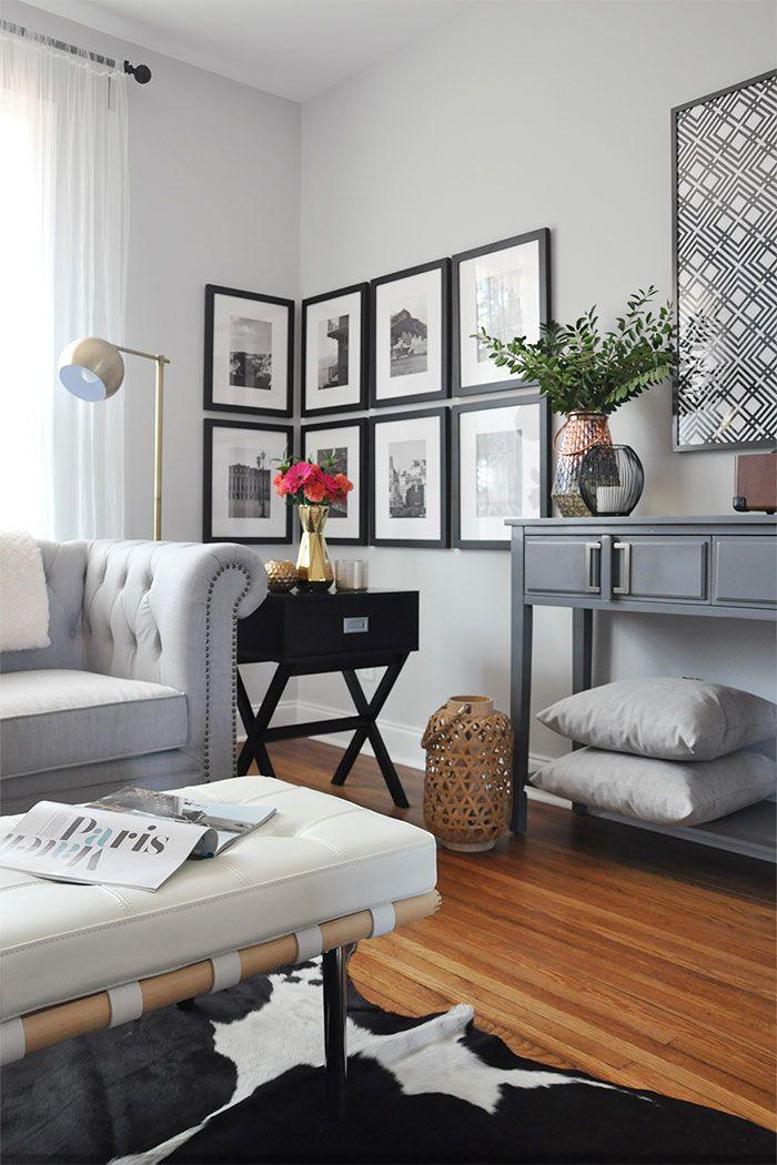 salon-decorado-en-tonos-blanco-negro-y-gris-cuadros-en-esquina.jpg ...