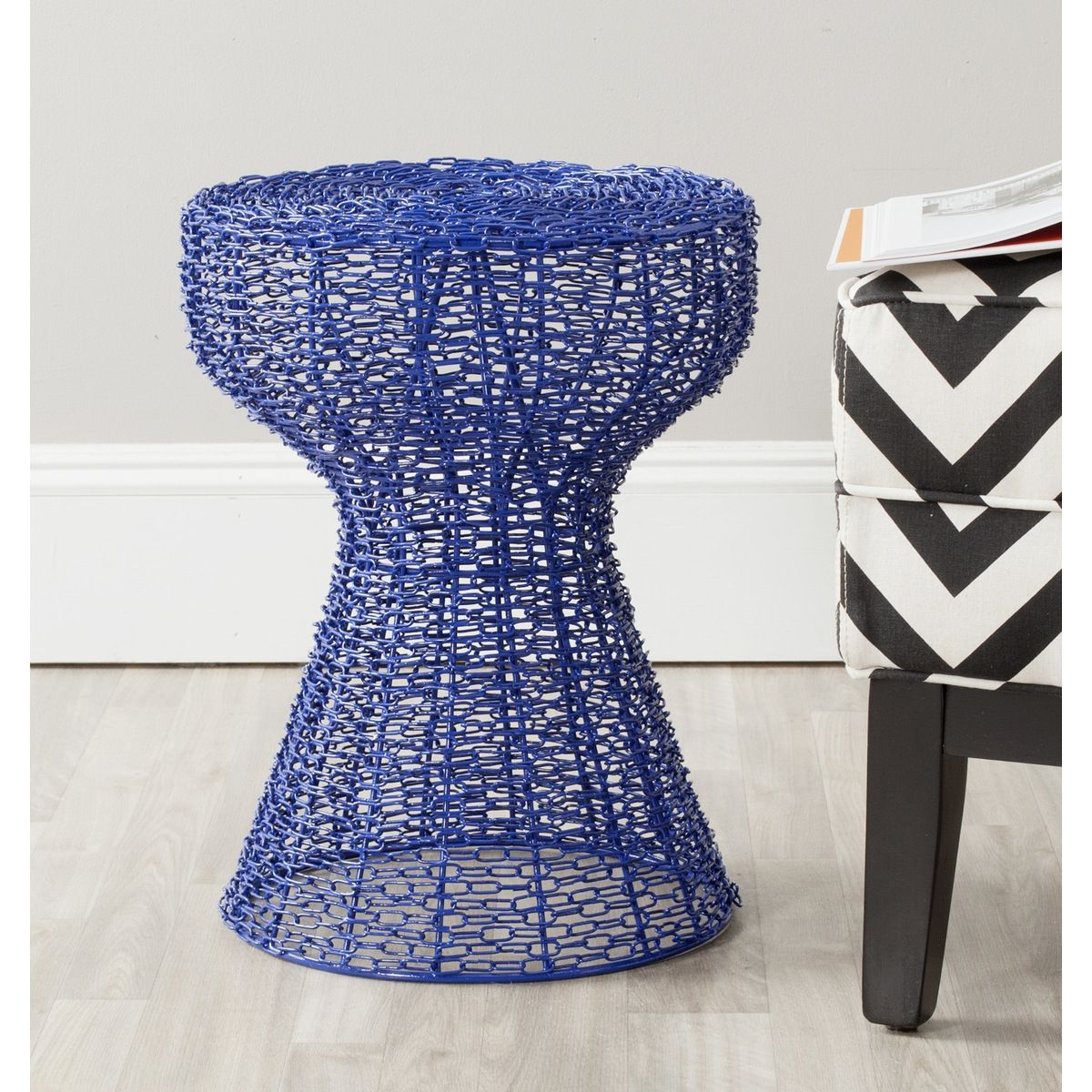 The Tabitha iron chain stool is your link to a subtle modern update in the casual interior spaces. The industrial-inspired pattern of chain-link is softened by a black epoxy finish, ensuring that it adds just a whisper of urban chic to any decor.