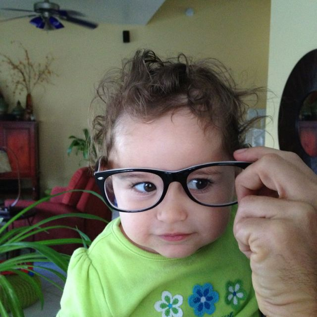 Rachel with daddy's glasses