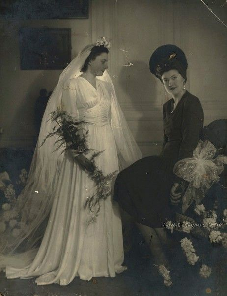 Bride & sister. Early 1940s. Love the veil. Wish weddings would be more formal today.
