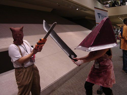 Hahaha chainsaw man from re4 vs pyramid head from the silent hill series