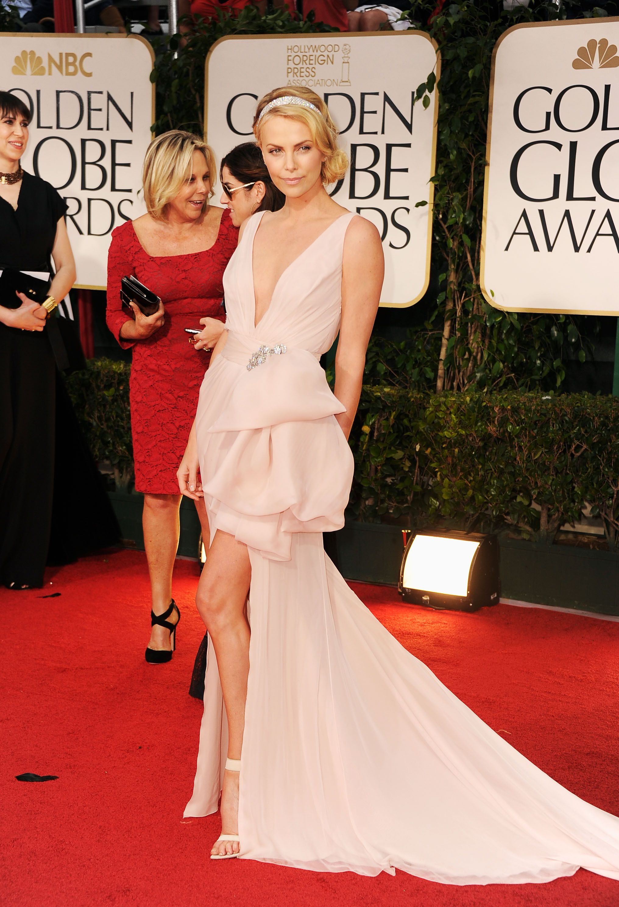 8f2a21a5d133f Charlize Theron arrives at the 69th Annual Golden Globe Awards held at the  Beverly Hilton Hotel on January 15, 2012 in Beverly Hills, California.