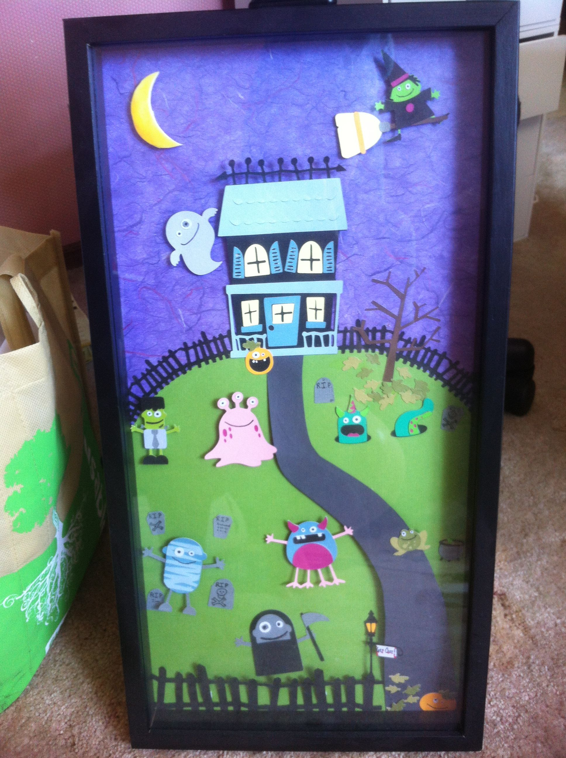 Cricut mini monsters Halloween decoration inside a shadow box frame - classroom door halloween decorations