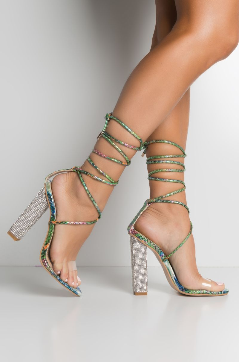 498255da69 The AKIRA Label All But A Dream Wrap Around Heeled Sandals has that killer  snake vibe we need to slay every look, with a faux snakeskin upper, ...