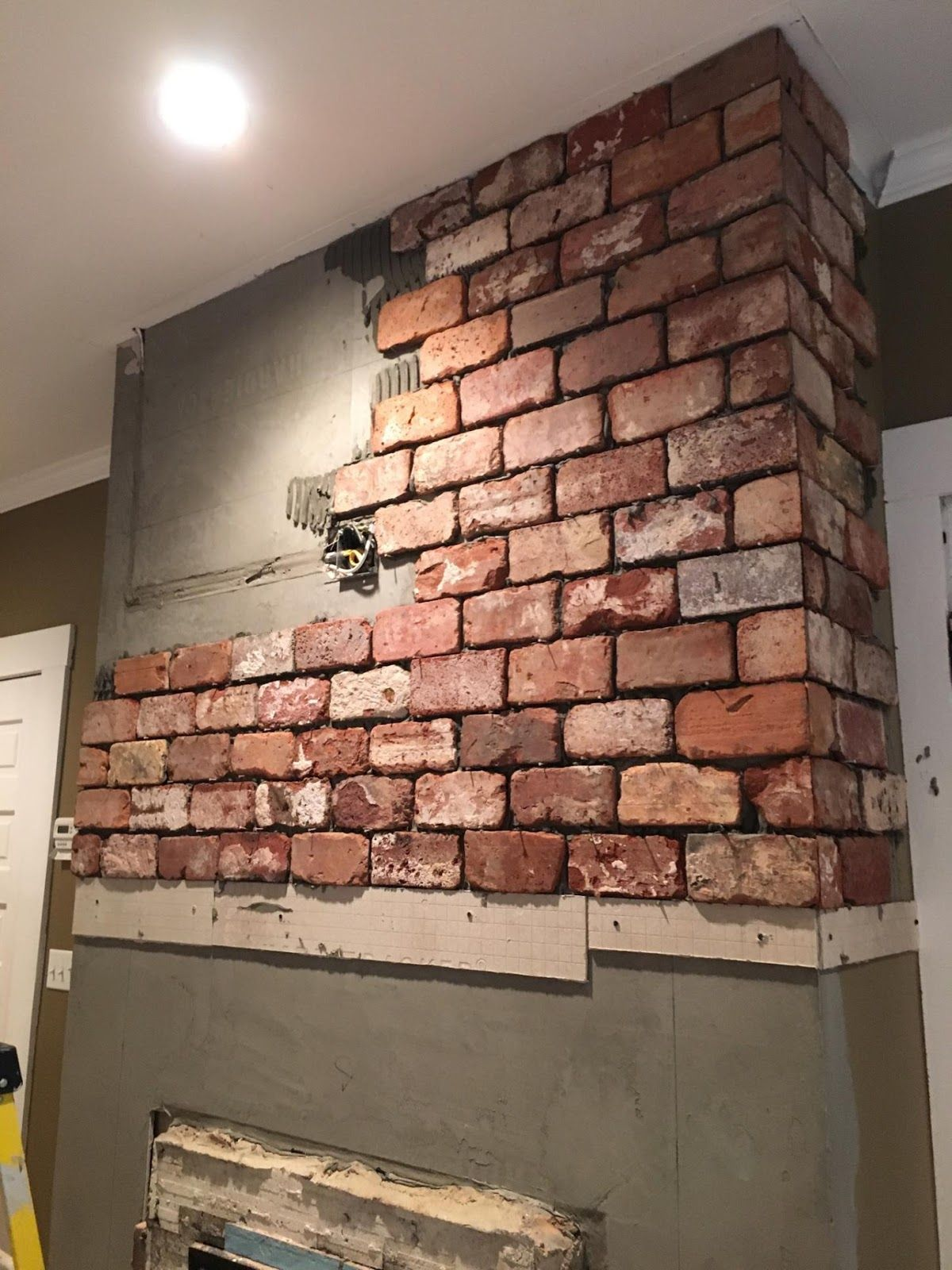 reclaimed thin brick tiles fireplace