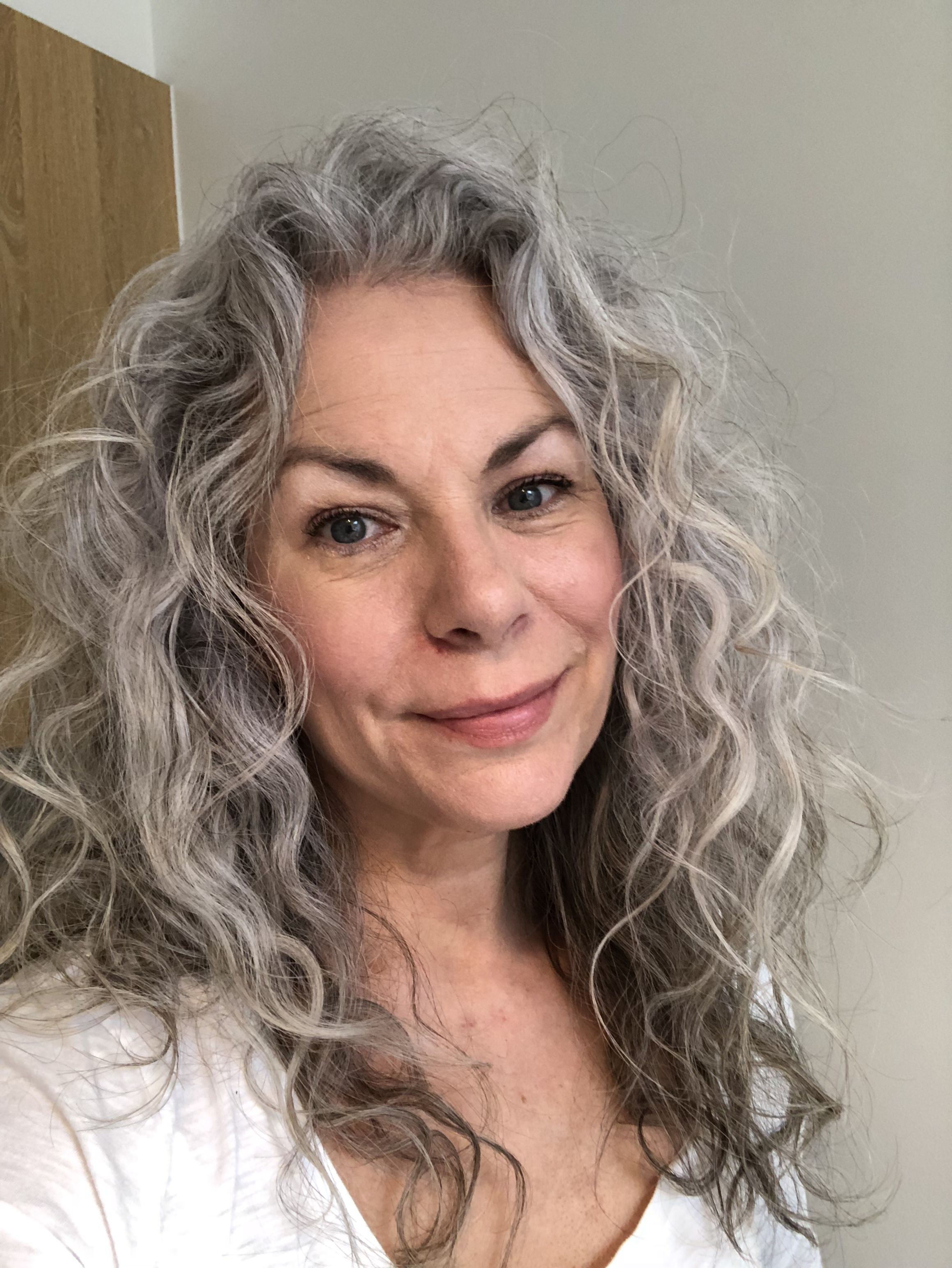 Naturally Grey And Curly Grey Hair Treatment Grey Curly Hair Beautiful Gray Hair