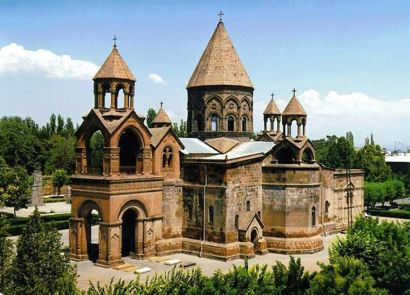 The Etchmiadzin Cathedral is the Mother Church of the Armenian Apostolic Church and the central building of the Mother See of Holy Etchmiadzin. Located in the center of the city of Vagharshapat, it is the first church to be built in Armenia. It is also considered the oldest cathedral in the world.  Along with several important early medieval churches located nearby, the Etchmiadzin Cathedral was listed as a World Heritage Site by UNESCO.