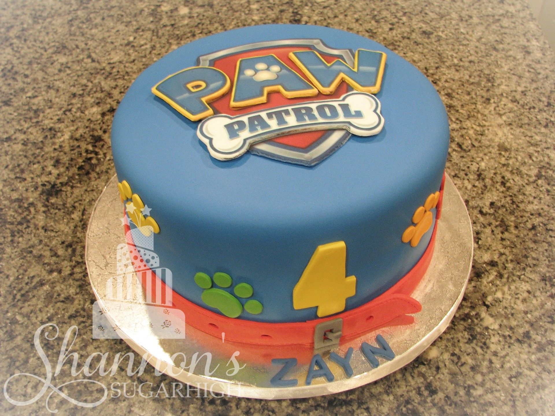 Paw Patrol round fondant covered cake Badge  crest