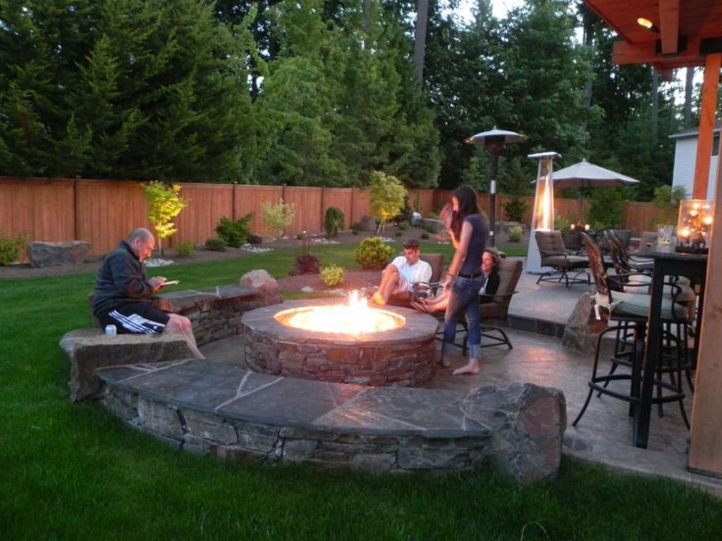 Stone Patio Ideas On A Budget With Round Fire Pit For Impressive Backyard Design Jpg 1024 768 Fire Pit Landscaping Fire Pit Patio Fire Pit Backyard