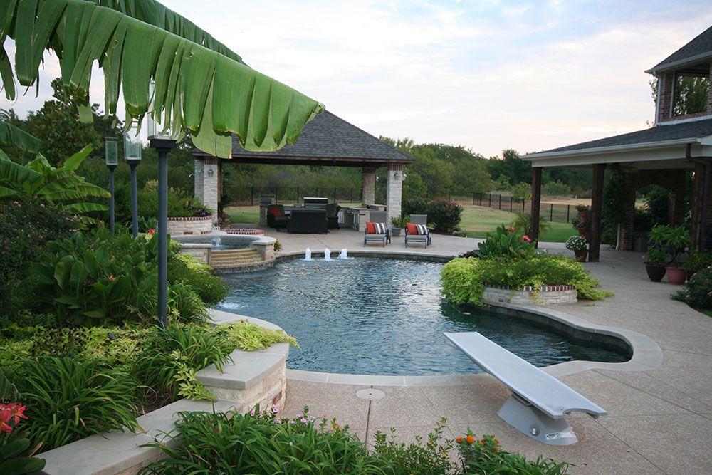 Ft Worth Custom Pool Design Photos Weatherford Keller 102 Free Form Pool Spa Outdoor Kitchen Endless Pool Pool Designs Backyard Pool Designs Custom Pools