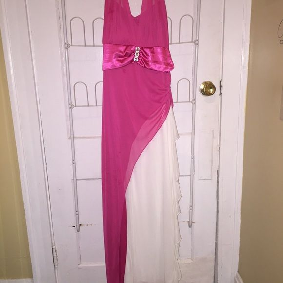 Pink and White Halter Dress Great for prom, weddings , or any other fancy event! This dress is beyond cute and I wish it fit me. Is pink with a white slit in the right side. Halter top that is more ribbon like. Size 1x from Taboo. If you have any questions please ask! Taboo Dresses Prom