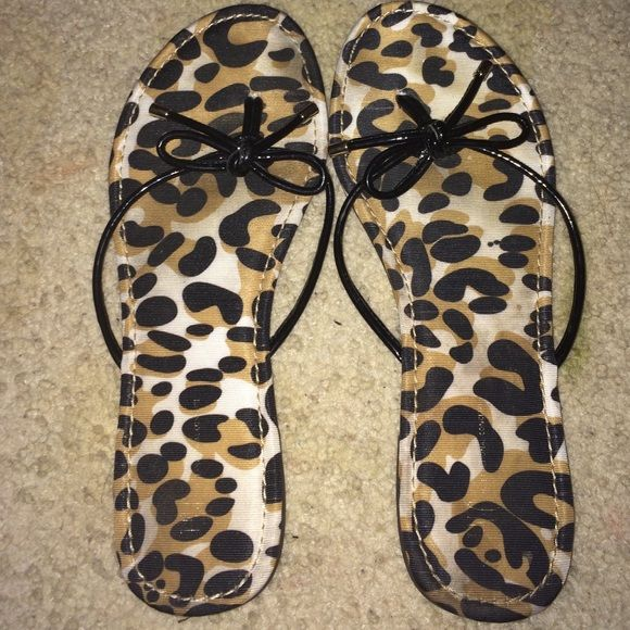 dd04832ac8abf2 Cheetah bow flip flops Size 8 cheetah bow flip flops. Gold accent. Never  worn Shoes Sandals
