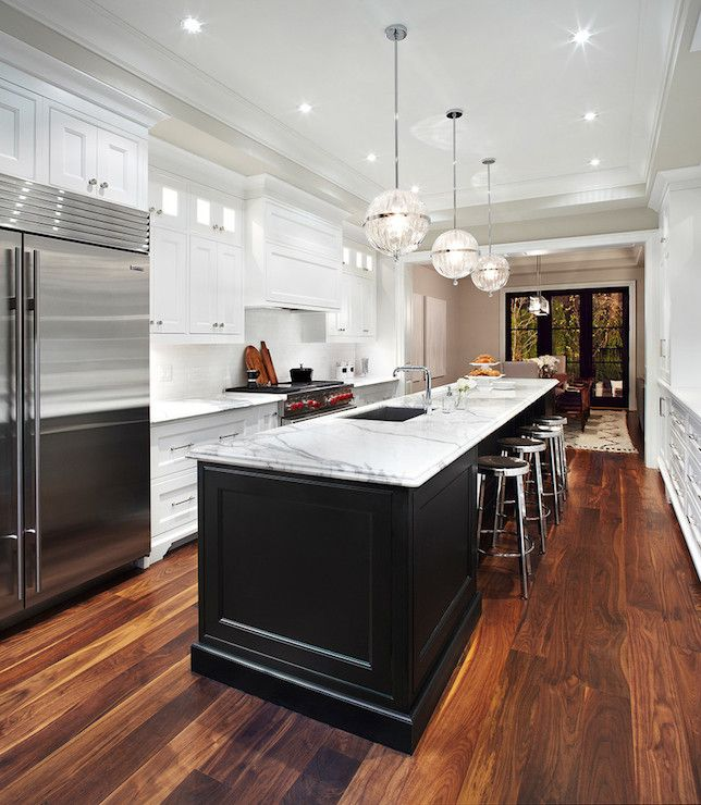 Long kitchen island transitional kitchen the design for Black and white galley kitchen