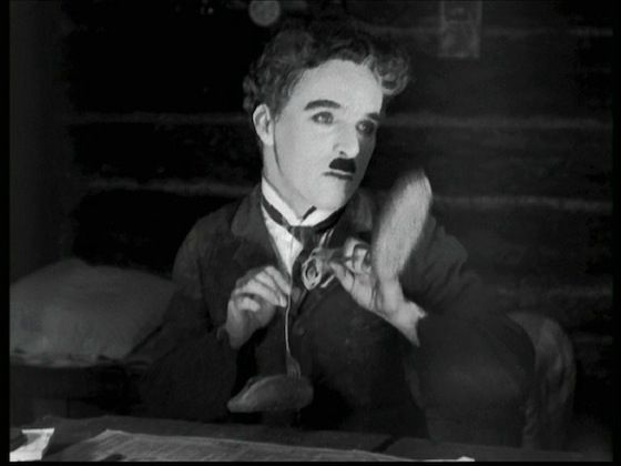 """The Lone Prospector (Charlie Chaplin): """"I'm so h-h-happy - Oh, I can't... But I'll dance the Oceana Roll."""" -- from The Gold Rush (1925) directed by Charlie Chaplin"""