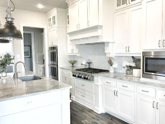 White Kitchen the cabinets the backsplash and most importantly the view perfection by oakley home Kitchen White And Grey Quartzite Countertop White And