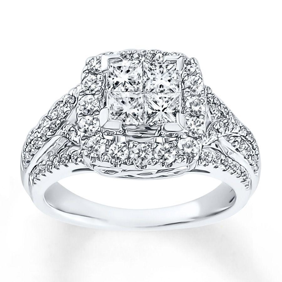Four brilliant princess-cut diamonds nestle in a frame of round ...