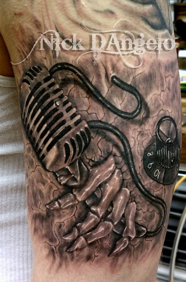 3D Tattoo Of Skeletal Hand Holding On To A Mic.