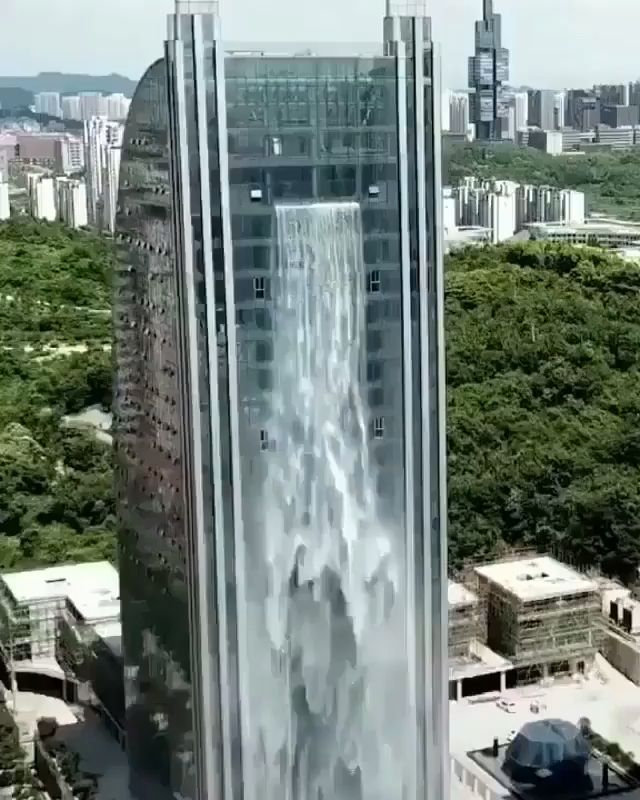 ‪This incredible man made waterfall is rarely turned on, as it costs a whopping $160/hr to run. It goes without saying that China continues to strive for the Worlds attention with bizarre architectural creations. See more at slay lifestyle #bizzare #slaylebrity #china #architecture #art #waterfall #manmadewaterfall #liebianbuilding‬