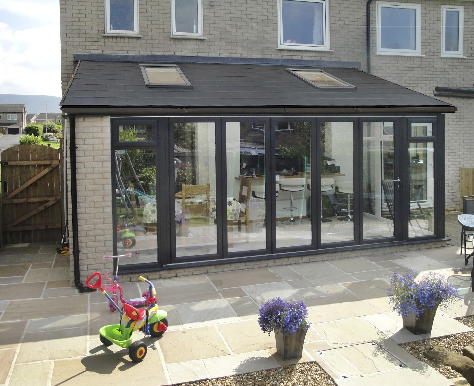 image result for narrow lean to conservatory with bifold