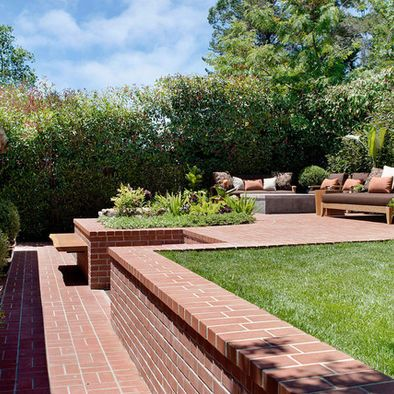 Tiered landscape design red bricks love the flow between for Tiered garden designs