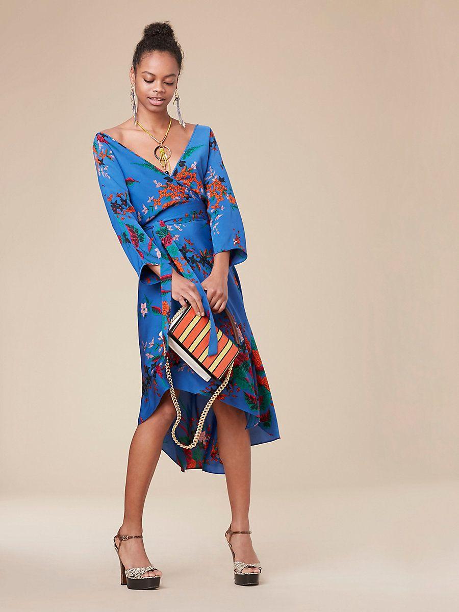 Cut in 100% printed woven silk crepe de Chine, this asymmetric mini dress is