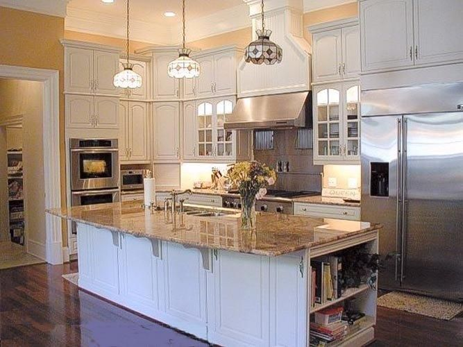 White Cabintes With Brown Countertops Dark Floors Brown Tone